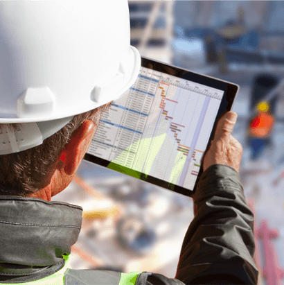 Infrastructure Spending: Construction worker looking at a tablet